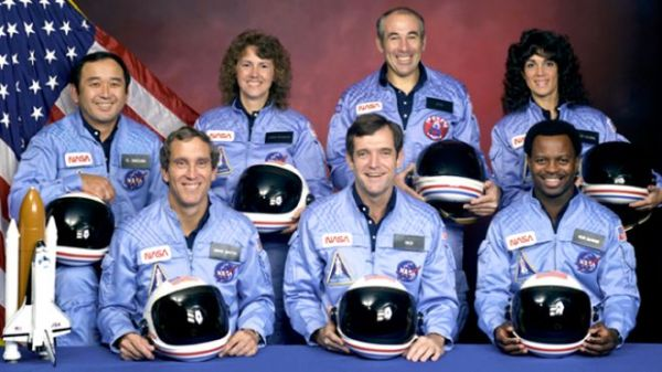 Challenger astronauts  (back row) Ellison S. Onizuka, Sharon Christa McAuliffe, Greg Jarvis, and Judy Resnik; (front row) Mike Smith, Dick Scobee, and Ron McNair. Photo courtesy of NASA.
